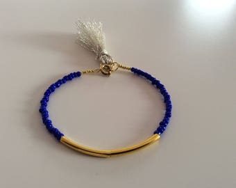 Blue, gold and beige beaded bracelet