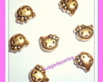 set of 13 kitty cat gold colored beads