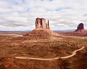 Monument Valley Navajo Tribal Park is a red sand desert on the Arizona-Utah border known for its towering sandstone buttes.