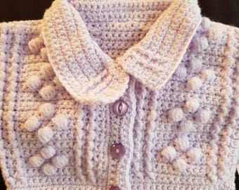 Crocheted baby girl cardigan