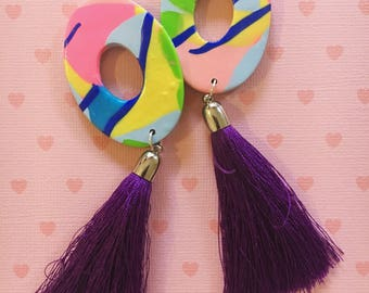 Large colourful oval hoop earrings with long purple tassels