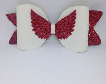 White jelly bow with red glitter tails and holographic red angel wings