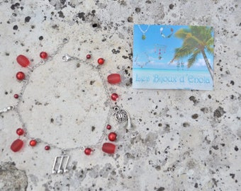 charm bracelet red beads, violin, music instrument