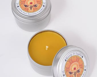 4 inch round Beeswax Travel Tin Candle. Made with 100% pure yellow Beeswax and a primed Wick. Clean burning, natural honey smell.