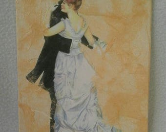 Painting, made with the technique of decoupage, depicting a couple in love with newlyweds, dancing