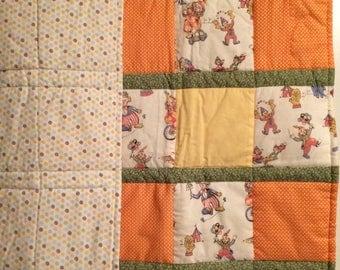 Hand made, gender neutral, modern baby quilt, toddler quilt, baby girl quilt, baby boy quilt, circus theme, polka dots.