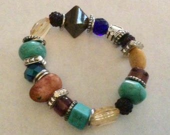Turquoise and silver plus other stones stretch bracelet