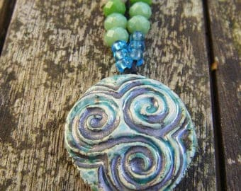 Triple spiral pendant on beaded Necklace
