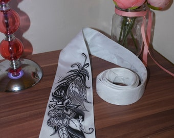 Beautiful, handmade tie with a feather