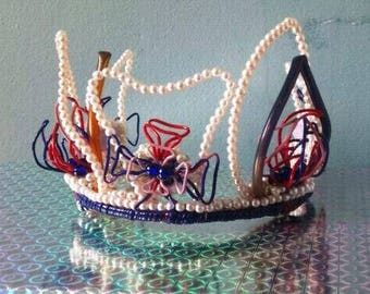 We made this none precious crown for the Queen's Jubilee in 2012, our work Bold head pieces, Made to order, Bespoke its a 'CALL OUT'