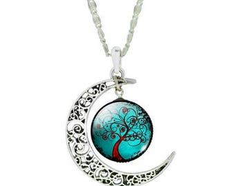 Silver pendant necklace with moon and red tree charm