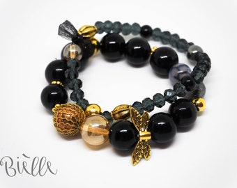 Unique beaded set of two bracelets in Gold/Black by Bielle | Women's accessories | Fashion | Style