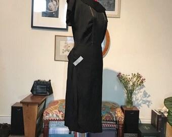 Beautiful mid 1940s black crepe evening dress with diamanté hip design