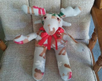 Moose in fleece novelty print. Safety lock eyes. Hypoallergenic stuffing. Measures 16 long. Great idea for Christmas. For all ages.