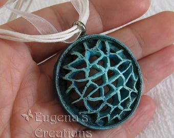 Openwork Pendant, Voronoi-style jewelry, blue pendant on a white ribbon necklace