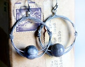 Fossil - Strung-Out guitar string hoop earrings with Petosky stones