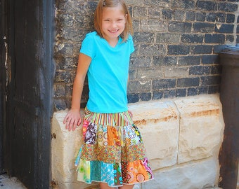 """The """"MUST HAVE"""" for bigger girls - Twirl and swirl in this patchwork skirt.  5T-12Y"""