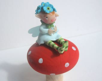 Fairy on a toadstool