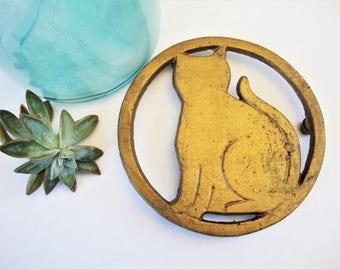 vintage cat trivet cast iron painted gold