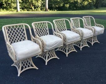 5 BOHO CHIC rattan swivel arm chairs