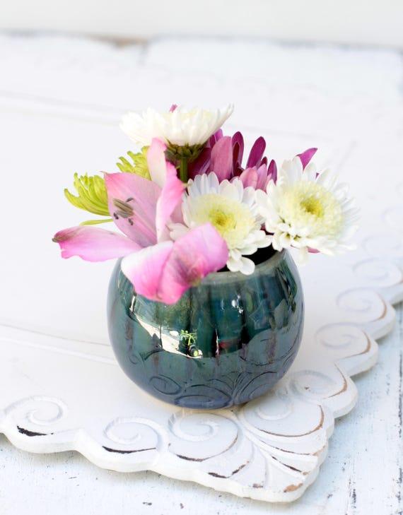 glossy blue bud vase