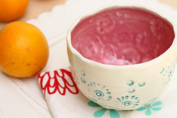 pink and teal ceramic bowl
