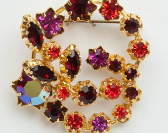 1950s 60s Made in Austria Faceted Purple Red Orange Rhinestones Open Design Swirl Double Circle Vintage Mid Century Cocktail Pin Brooch
