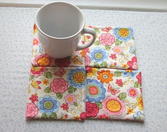 peach pink and blue flowers hand quilted set of mug rugs coasters