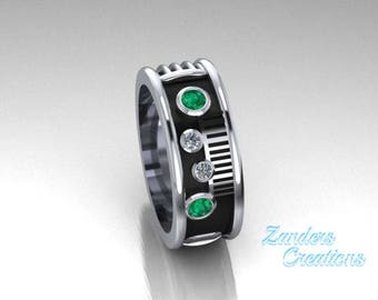 Saber Ring with a genuine emerald and diamonds set in 14k white gold