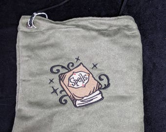 Green spell book embroidered pouch