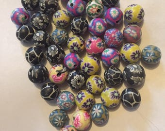 Pack of 45 x 10mm polymer clay round mix of various coloured flower etc beads.