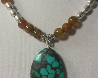 Stunning colors in this Turquoise and brown beaded one-of-a-kind necklace.