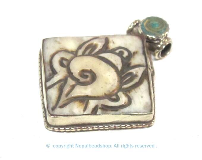 Ethnic Tibetan cream color carved Bone auspicious conch shell symbol pendant - PM594A