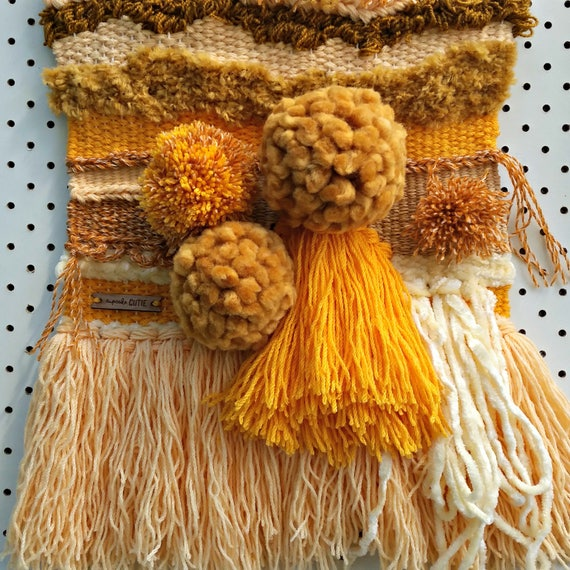 Mustard wall hanging. Woven fiber art. Modern weaving with pom pom detail. Thrifted yarn.