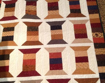 Quilt with spools and reproduction fabric longarm quilted