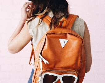 Groovy orange backpack with sunglasses