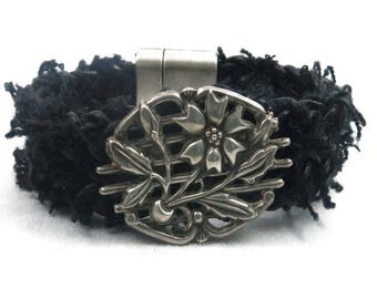 Antique Sterling Silver Flower on a Black Leather and Fiber Braided Bracelet