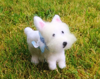 Westie figurine wearing a light blue collar with flower