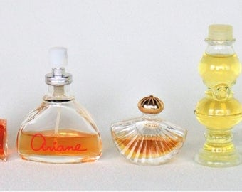 5 Bottles Of Avon Fragrances Cotillion Fantastique Topaz Ariane And To A Wild Rose