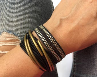 set of bracelets in a bronze and black. boho jewelry. Zipper bracelet with toggle clasp. Double wrap leather bracelet.