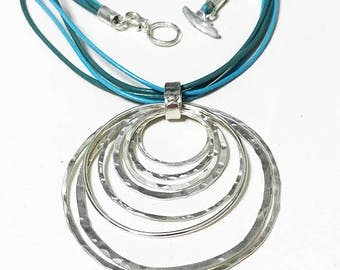 Sterling Silver  Circle Hoops  Pendant with Turquoise Leather traps.