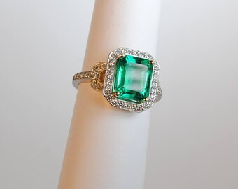 Modern 18kt 3.03 carat Emerald & Diamond Ring