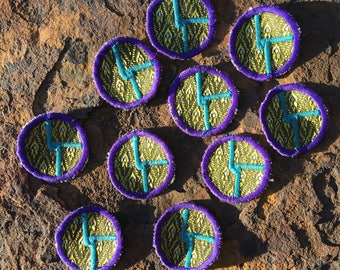 The Disco Biscuits logo Whittle patch in purple gold and turquoise
