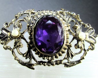 Gorgeous Faceted Glass Oval Amethyst in Goldtone Filigree Brooch with Faux Pearl Accents and Applied Patina