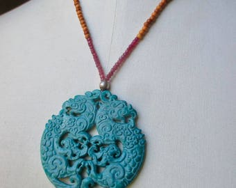 Statement carved jade necklace with large blue pendant, sandalwood and rubies advanced style bold summer necklace