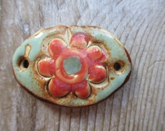 focal bead...Pendant or bracelet bead...coral  and aqua  flower...handmade ceramic