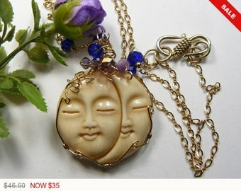 """Carved Bone, Double Sun and Moon Face necklace, wire wrapped with 14k gold fill wire, 20 """" handmade chain. (W10363)"""