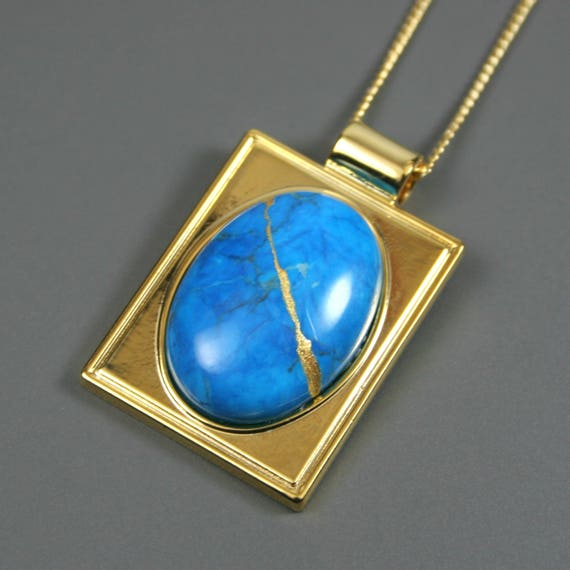 Kintsugi (kintsukuroi) turquoise howlite stone cabochon with gold repair in a rectangular gold plated setting on gold chain - OOAK
