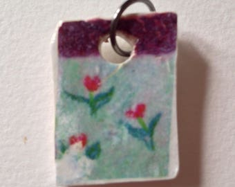 Faux ceramic chip polymer clay piece.