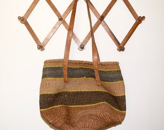 Vintage sisal purse...sisal bag with leather straps...sisal market bag with thick stripes...rounded bottom.